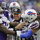 AP10ThingsToSee - Line judge John Hussey separates Minnesota Vikings' Greg Jennings (15) and Buffalo Bills' Stephon Gilmore (24) during the second half of an NFL football game Sunday, Oct. 19, 2014, in Orchard Park, N.Y The Associated Press