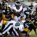 Pittsburgh Steelers' LeGarrette Blount (27) is tackled by Philadelphia Eagles' Trent Cole (58) and others during the first half of an NFL preseason football game, Thursday, Aug. 21, 2014, in Philadelphia The Associated Press