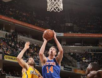INDIANAPOLIS, IN - MARCH 4: Jason Smith #14 of the New York Knicks shoots the ball against the Indiana Pacers during the game on March 4, 2015 at Bankers Life Fieldhouse in Indianapolis, Indiana. (Photo by Ron Hoskins/NBAE via Getty Images)