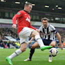 West Brom's Gareth McAuley, right, blocks Manchester United's Wayne Rooney during the English Premier League soccer match between West Bromwich Albion and Manchester United at The Hawthorns Stadium in West Bromwich, England, Saturday, March 8, 2014