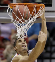 Arizona's Nick Johnson dunks the ball against Colorado during the second half of an NCAA college basketball game in the semifinals of the Pac-12 Conference on Friday, March 14, 2014, in Las Vegas. Arizona won 63-43. (AP Photo/Julie Jacobson)