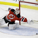 New Jersey Devils goalie Cory Schneider (35) cannot stop a shot on goal by San Jose Sharks' Raffi Torres during the second period of an NHL hockey game on Sunday, March. 2, 2014, in Newark, N.J The Associated Press