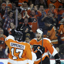 Philadelphia Flyers' Luke Schenn, right, and Wayne Simmonds celebrate Schenn's goal during the second period of an NHL hockey game against the Edmonton Oilers, Tuesday, Nov. 4, 2014, in Philadelphia The Associated Press