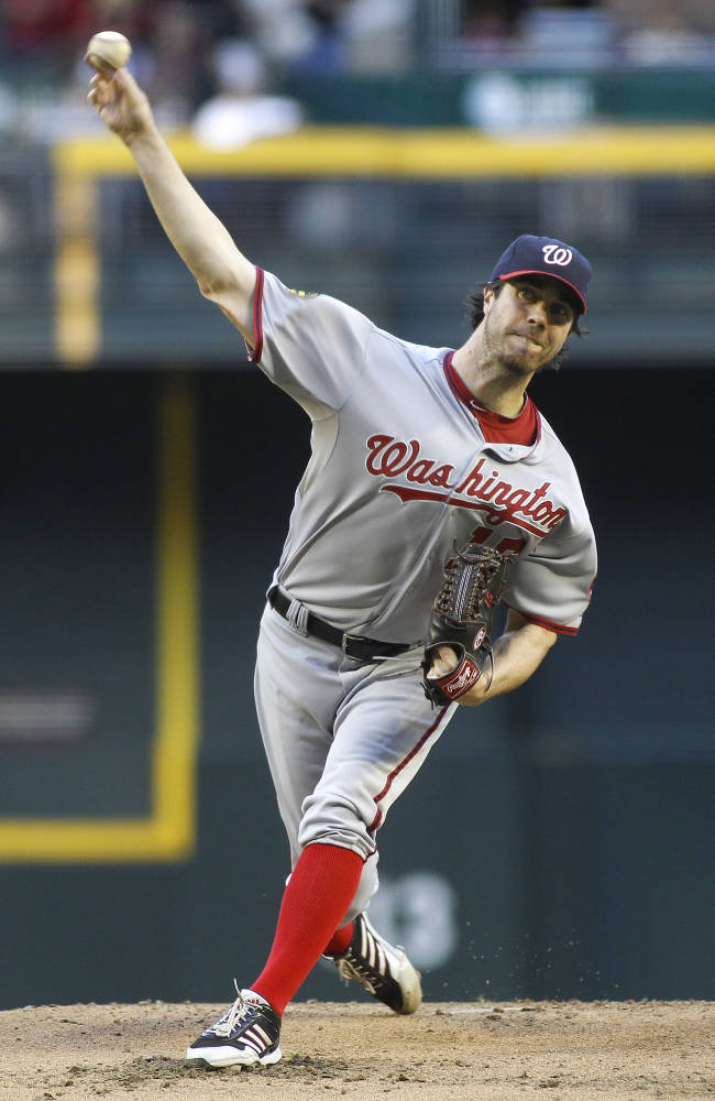 Washington Nationals pitcher Dan Haren delivers against the Arizona Diamondbacks during the first inning of a baseball game on Saturday, Sept. 28, 2013, in Phoenix