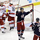 Columbus Blue Jackets' Artem Anisimov, of Russia, and Nathan Horton (8) celebrate Anisimov's goal against the Carolina Hurricanes during the third period of an NHL hockey game in Raleigh, N.C., Saturday, March 29, 2014. Columbus won 3-2 in overtime The As