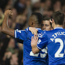Chelsea's Eden Hazard, centre, celebrates with teammates Samuel Eto'o and Cesar Azpilicueta, after scoring against Tottenham Hotspur, during their English Premier League soccer match, at the Stamford Bridge Stadium in London, Sunday, March 8, 2014
