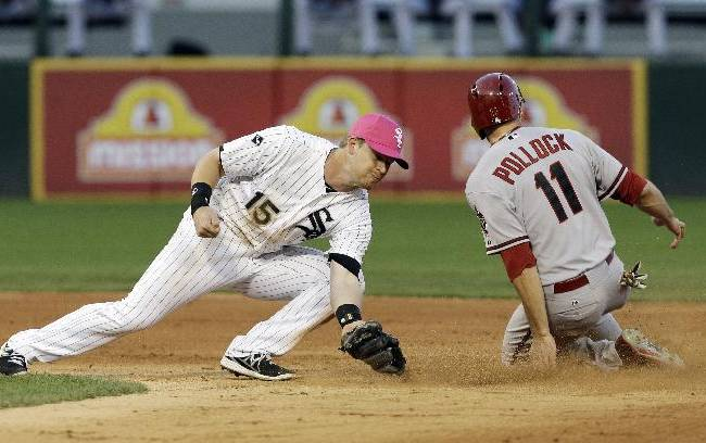 Arizona Diamondbacks' A.J. Pollock, right, steals second base as Chicago White Sox second baseman Gordon Beckham applies a late tag during the fifth inning of an interleague baseball game in Chicago, Saturday, May 10, 2014