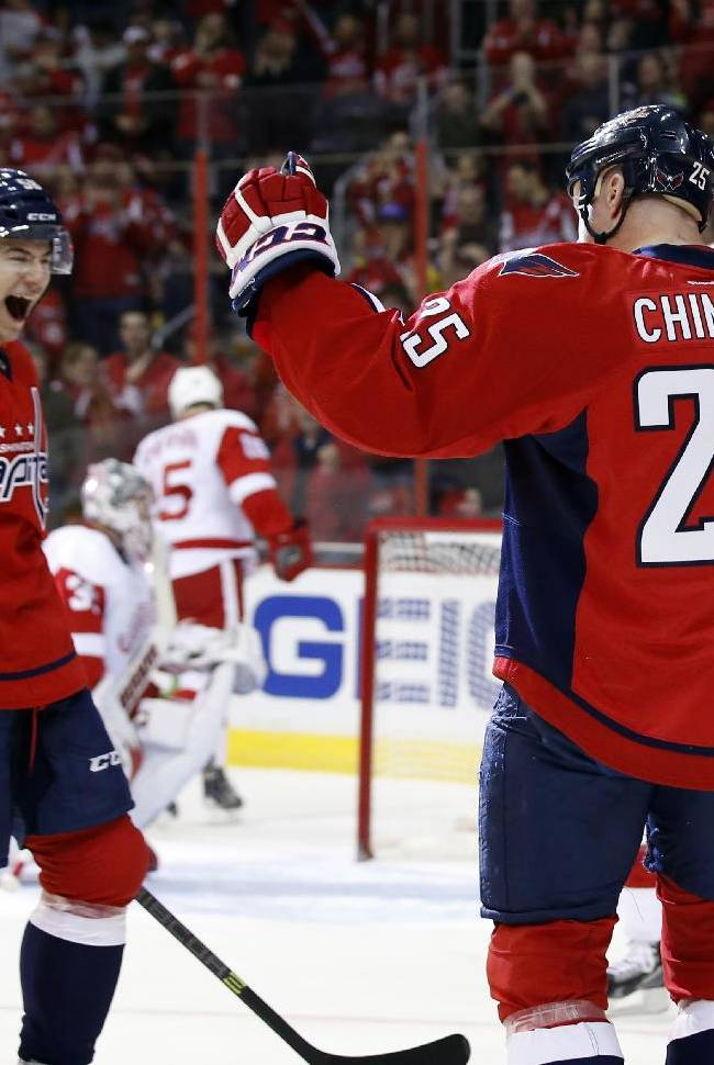 Washington Capitals defenseman Connor Carrick (58) celebrates with left wing Jason Chimera (25) after Chimera's goal in the first period of an NHL hockey game against the Detroit Red Wings, Sunday, Feb. 2, 2014, in Washington