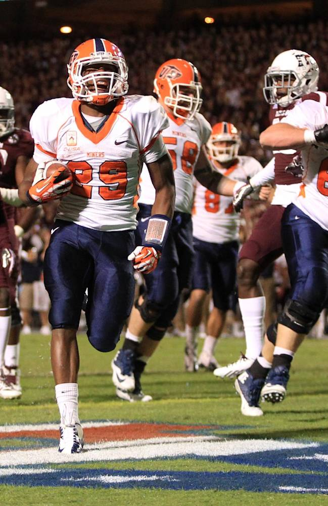 UTEP's Aaron Jones (29) scores a touchdown during the first half of an NCAA football game against Texas A&M, Saturday, Nov. 2, 2013 in College Station,Texas