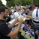 Indianapolis Colts quarterback Andrew Luck signs autographs for fans as the players arrived for the NFL team's football training camp in Anderson, Ind., Wednesday, July 23, 2014 The Associated Press