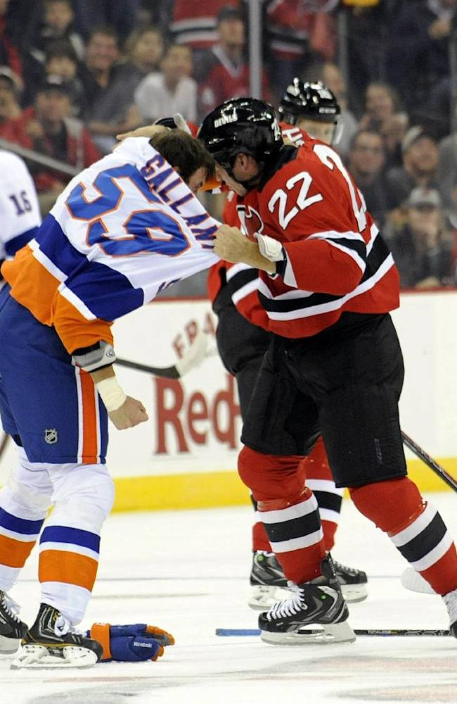 New York Islanders' Brett Gallant, left, fights with New Jersey Devils' Krys Barch during the first period of a preseason NHL hockey game, Thursday, Sept. 19, 2013, in Newark, N.J