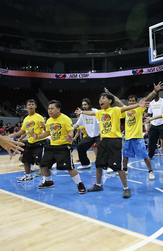 Indiana Pacers team coach Frank Vogel conducts a basketball clinic to Filipino Special Olympics athletes Wednesday, Oct. 9, 2013, at the Mall of Asia Arena in Pasay city, south of Manila, Philippines. The Indiana Pacers will play against the Houston Rockets on Thursday in the first NBA game in this basketball-obsessed Southeast Asian nation, part of the NBA's global schedule that will have eight teams play in six countries this month