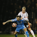 Fulham's Jack Grimmer, behind, vies for the ball with Sunderland's Steven Fletcher during the English FA Cup fourth round replay soccer match between Fulham and Sunderland at Craven Cottage stadium in London, Tuesday, Feb. 3, 2015