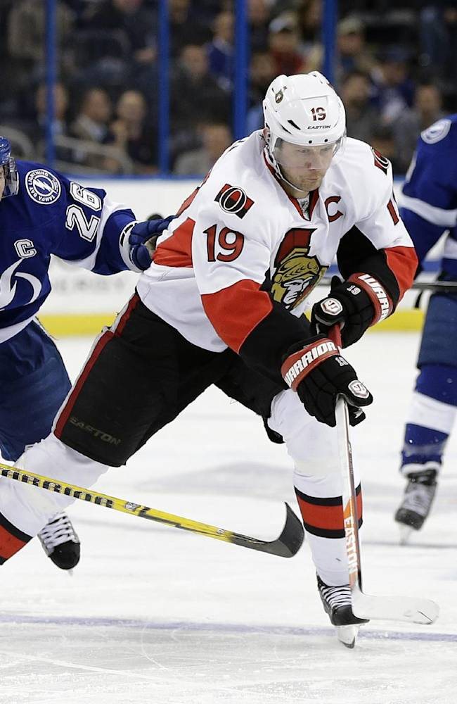 Ottawa Senators center Jason Spezza (19) cuts between Tampa Bay Lightning right wing Martin St. Louis (26) and center Tyler Johnson (9) during the first period of an NHL hockey game Thursday, Jan. 23, 2014, in Tampa, Fla