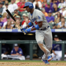 Los Angeles Dodgers' Yasiel Puig spins in the batter's box after getting hit by a pitch against the Colorado Rockies in the fourth inning of a baseball game in Denver on Monday, Sept. 2, 2013. (AP Photo/David Zalubowski)