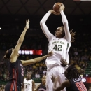 Baylor's Brittney Griner shoots against Texas Tech's Shauntal Nobles (33) and Chynna Brown (00) during the first half of an NCAA college basketball game Tuesday, Feb. 12, 2013, in Dallas. (AP Photo/LM Otero)