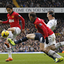 Manchester United s Shinji Kagawa, left, competes for the ball with Tottenham Hotspur s Vlad Chiriches as Manchester United s Wayne Rooney looks on during their English Premier League soccer match at White Hart Lane, London, Sunday, Dec. 1, 2013