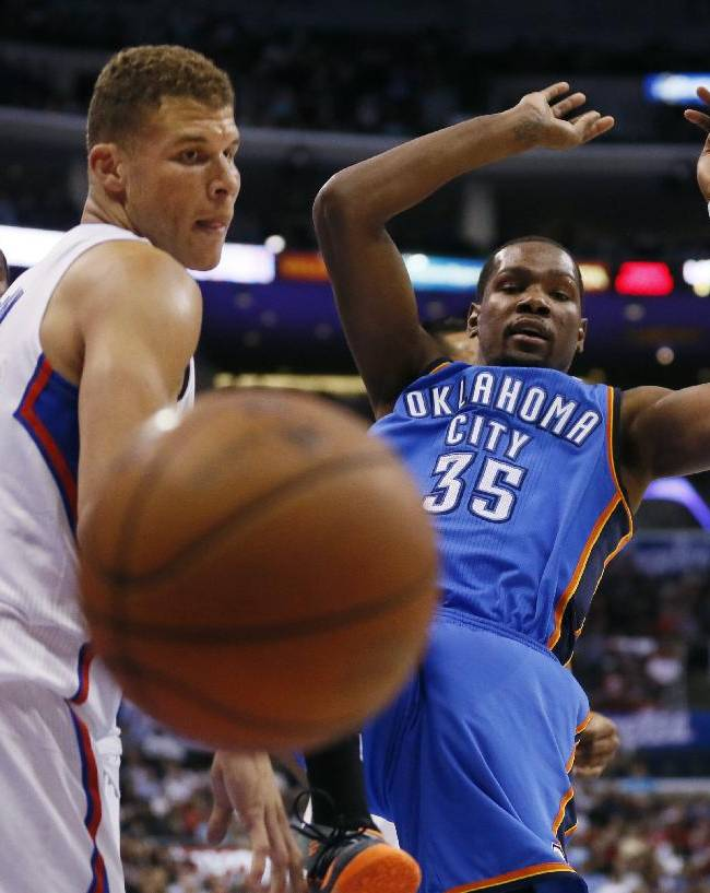 Oklahoma City Thunder forward Kevin Durant loses the ball after being fouled by Los Angeles Clippers forward Matt Barnes, not seen, as Clippers' Blake Griffin, left, defends during the first half of an NBA basketball game in Los Angeles, Wednesday, April 9, 2014