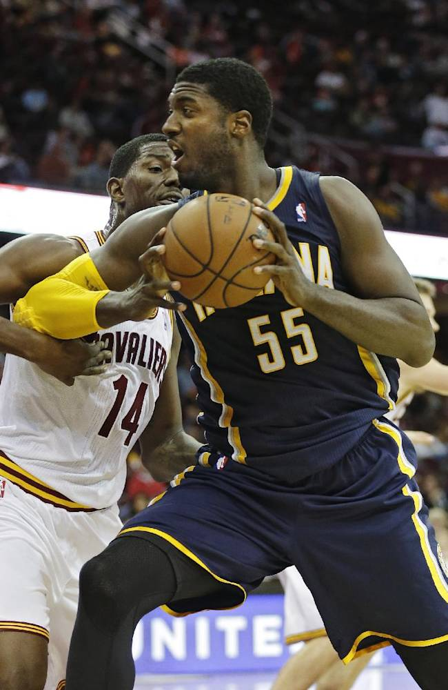 Indiana Pacers' Roy Hibbert (55) makes a  drive on Cleveland Cavaliers' Henry Sims (14) in the second quarter of a preseason NBA basketball game Saturday, Oct. 19, 2013, in Cleveland