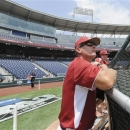 FILE - In this June 14, 2012, file photo, Arkansas coach Dave Van Horn watches batting practice at TD Ameritrade Park in Omaha, Neb. The Razorbacks are ranked No. 1 in three major polls after tying for third in last year's CWS. (AP Photo/Eric Francis, File)