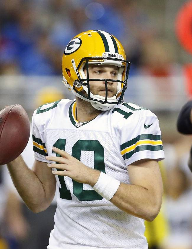 CORRECTS QUARTERBACK NAME FROM AARON RODGERS TO MATT FLYNN: Green Bay Packers quarterback Matt Flynn looks downfield during the first quarter of an NFL football game against the Detroit Lions at Ford Field in Detroit, Thursday, Nov. 28, 2013