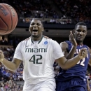 Miami's Reggie Johnson and Illinois' Nnanna Egwu go after a loose ball during the first half of a third-round game of the NCAA college basketball tournament Sunday, March 24, 2013, in Austin, Texas. (AP Photo/David J. Phillip)