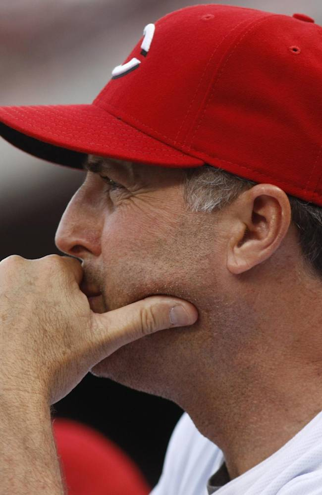 In this May 26, 2012, file photo, Cincinnati Reds pitching coach Bryan Price watches a baseball game against the Colorado Rockies, in Cincinnati. The Reds have chosen Price to replace Dusty Baker as their next manager, according to a person familiar with the decision. The club plans to introduce the 51-year-old Price at a news conference later Tuesday, Oct. 22, 2013. The person spoke on condition of anonymity because no announcement had been made