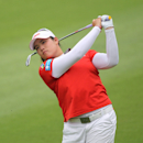 Ariya Jutanugarn of Thailand plays a shot from a fairway during the final round of the LPGA Thailand golf tournament in Pattaya, southern Thailand, Sunday, Feb. 24, 2013. (AP Photo/Sakchai Lalit)