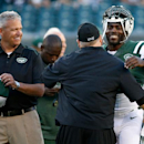 New York Jets' Michael Vick, right, and head coach Rex Ryan, left, meet with Philadelphia Eagles head coach Chip Kelly before an NFL preseason football game, Thursday, Aug. 28, 2014, in Philadelphia The Associated Press