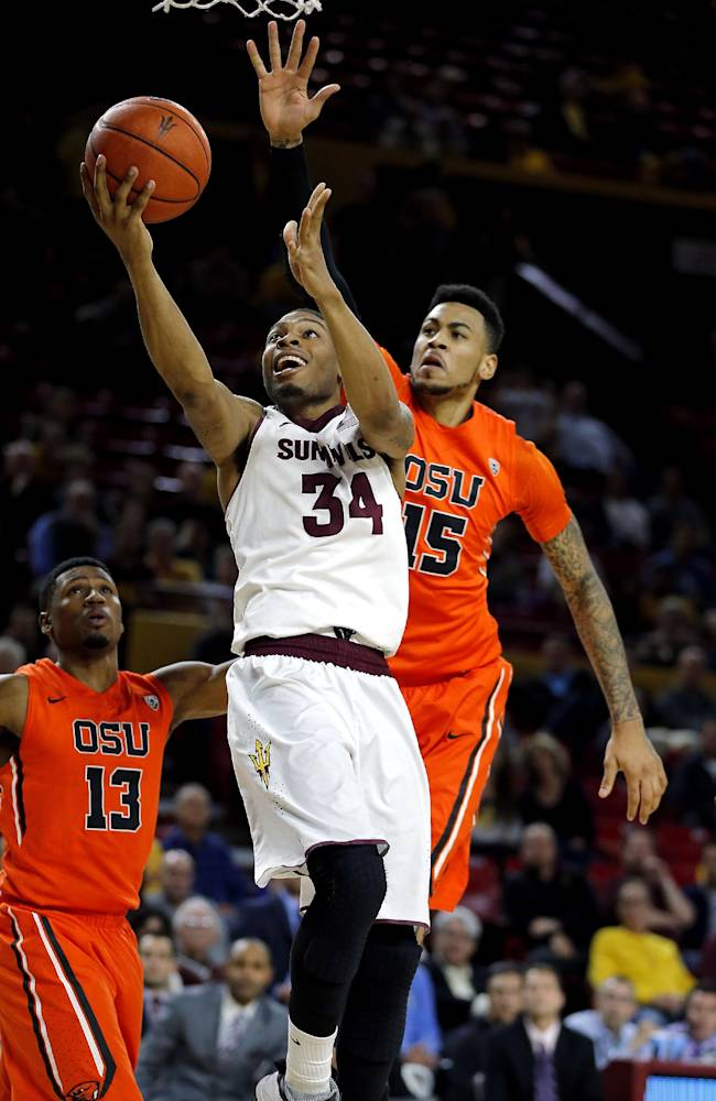 Arizona State's Jermaine Marshall (34) drives past Oregon State's Eric Moreland (15) during the second half of an NCAA college basketball game, Thursday, Feb. 6, 2014, in Tempe, Ariz