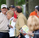 <p>Jay Haas found an old friend in the gallery en route to taking the early lead.(Getty Images)</p>