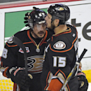 In this May 16, 2014 file photo, Anaheim Ducks right wing Teemu Selanne, of Finland, left, gets a hug from center Ryan Getzlaf after they were defeated by the Los Angeles Kings in Game 7 of an NHL hockey second-round Stanley Cup playoff series in Anaheim,