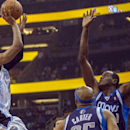 Orlando Magic's Arron Afflalo, left, shoots over the Dallas Maverics' Vince Carter and Samuel Dalembert, right, during the first half of an NBA basketball game in Orlando, Fla., Saturday, Nov. 16, 2013 The Associated Press