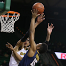 Baylor center Isaiah Austin (21) pressures West Virginia guard Terry Henderson (15), right, in the first half of an NCAA college basketball game, Tuesday, Jan. 28, 2014, in Waco, Texas. (AP Photo/Waco Tribune Herald, Rod Aydelotte)