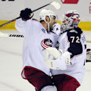 Columbus Blue Jackets left winger Nick Foligno, left, celebrates a win with goaltender Sergei Bobrovsky, of Russia, after an NHL hockey game season opener against the Buffalo Sabres, Thursday, Oct., 9, 2014, in Buffalo, N.Y. Columbus won 3-1 The Associate