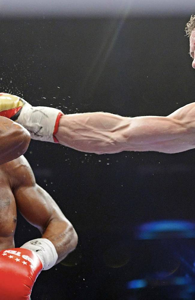 AP10ThingsToSee - Robert Stieglitz of Germany, right, lands a punch to Isaac Ekpo of Nigeria during their WBO Super Middleweight Championship title boxing match in Leipzig, central Germany, Saturday, Oct. 19, 2013. Stieglitz retained his title