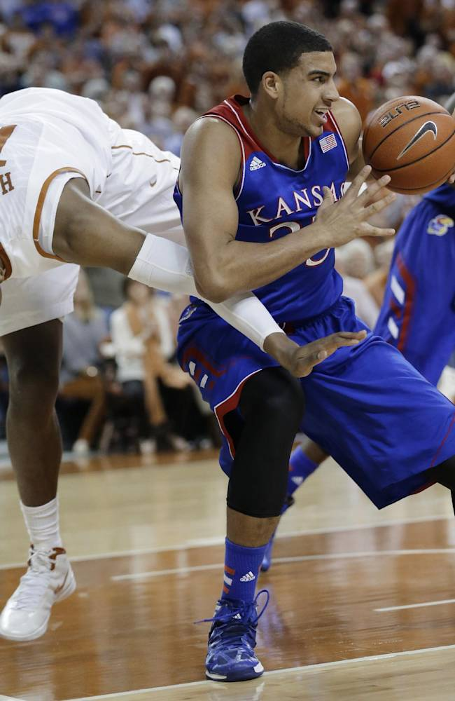Holmes powers No. 25 Texas over No. 6 Kansas 81-69