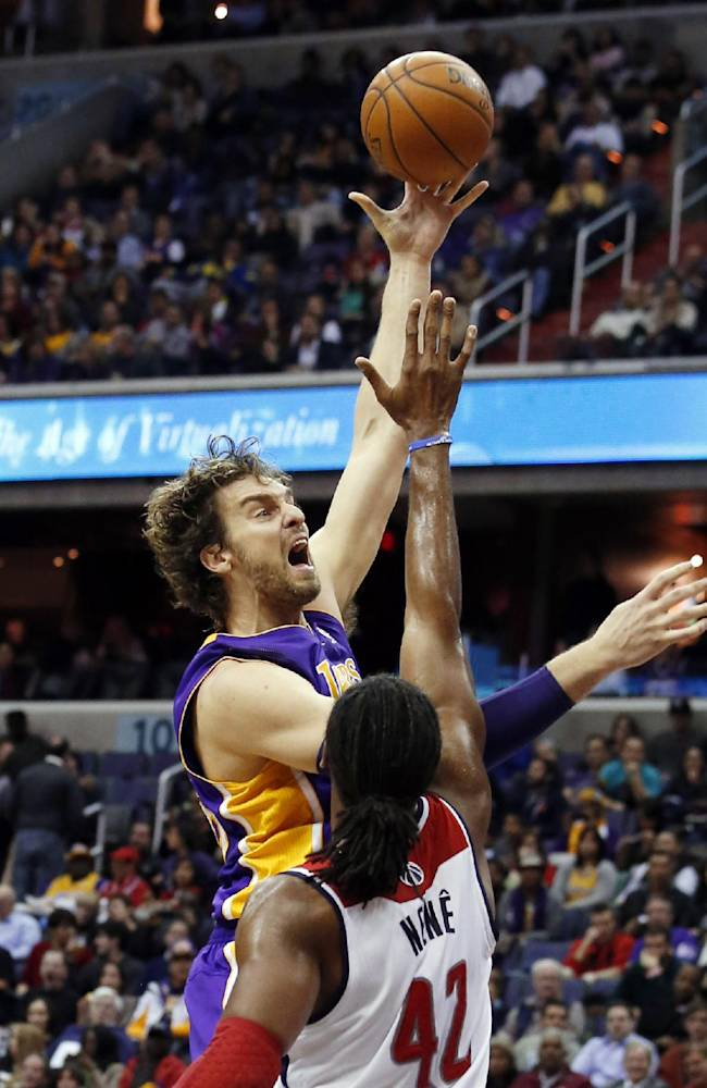 Los Angeles Lakers center Pau Gasol (16), from Spain, shoots over Washington Wizards forward Nene (42), from Brazil, in the first half of an NBA basketball game Tuesday, Nov. 26, 2013, in Washington