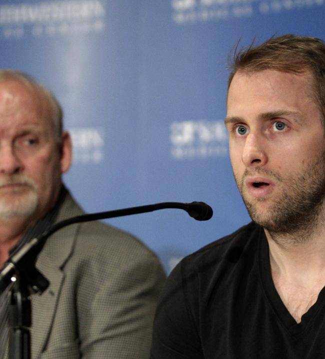 CORRECTS DATE TO MARCH 12 - Dallas Stars forward Rich Peverley, right, makes a statement regarding his health and the incident which occurred in a recent NHL game during a news conference at UT Southwestern Medical Center as coach Lindy Ruff looks on Wednesday, March 12, 2014, in Dallas. Peverley will not play again this season