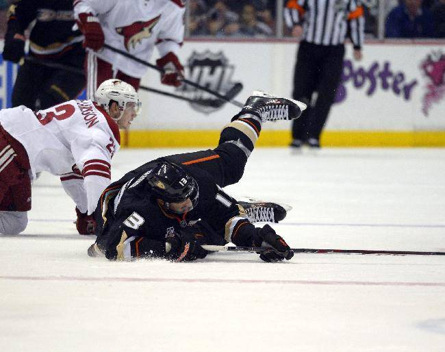 Anaheim Ducks center Nick Bonino, right, is tripped by Phoenix Coyotes defenseman Oliver Ekman-Larsson, of Sweden, during the second period of an NHL hockey game Wednesday, Nov. 6, 2013, in Anaheim, Calif