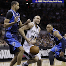 San Antonio Spurs' Manu Ginobili (20), of Argentina, is pressured by Dallas Mavericks' Brandan Wright (34) and Shawn Marion (0) during the first half of Game 2 of the opening-round NBA basketball playoff series on Wednesday, April 23, 2014, in San Antonio