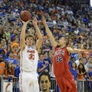 Florida forward/center Erik Murphy (33) shoots for 3 points as Mississippi guard Marshall Henderson (22) defends during the first half of an NCAA college basketball game in Gainesville, Fla., Saturday, Feb. 2, 2013. (AP Photo/Phil Sandlin)