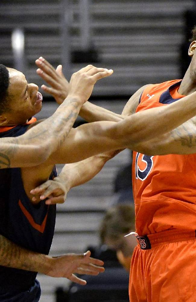 Illinois guard Joseph Bertrand (2) loses the rebound in front of Auburn's Chris Denson (3) and Tahj Shamsid-Deen, right, in the first half of an NCAA college basketball game on Sunday, Dec. 8, 2013, in Atlanta