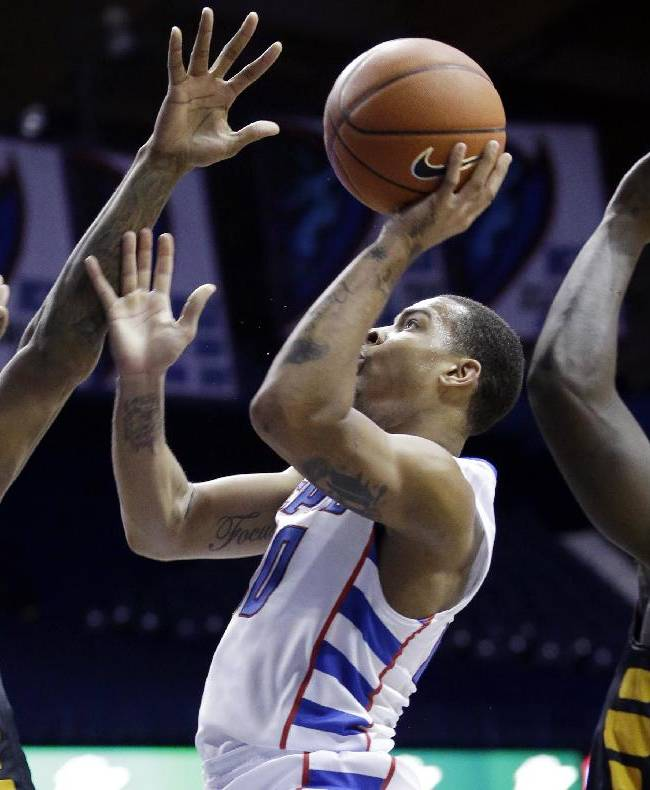 DePaul guard Brandon Young, center, drives to the basket against Southern Mississippi forward Daveon Boardingham, left, and forward Jerrold Brooks during the second half of an NCAA college basketball game in Rosemont, Ill., Wednesday, Nov. 13, 2013. Southern Mississippi won 75-68
