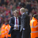 Liverpool's manager Brendan Rodgers, left, shakes hands with Southampton's manager Ronald Koeman after their English Premier League soccer match at Anfield Stadium, Liverpool, England, Sunday Aug. 17, 2014