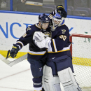 St. Louis Blues goalie Martin Brodeur (30) is congratulated by teammate Vladimir Tarasenko (91) after beating the Florida Panthers 4-2 in an NHL hockey game, Monday, Dec. 8, 2014, in St. Louis The Associated Press