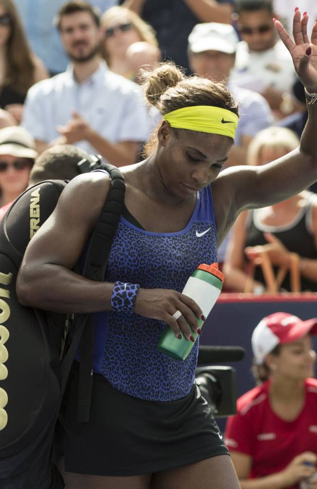 Serena Williams of the United States walks off the court after losing 6-7, 6-2, 6-3 to her sister Venus during semifinal play at the Rogers Cup tennis tournament Saturday, Aug. 9, 2014 in Montreal. (AP Photo/The Canadian Press, Paul Chiasson)