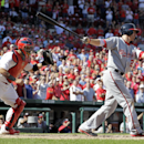 St. Louis Cardinals catcher Yadier Molina, left, celebrates as Washington Nationals' Adam LaRoche strikes out swinging for the final out of a baseball game Wednesday, Sept. 25, 2013, in St. Louis. The Cardinals won 4-1 The Associated Press