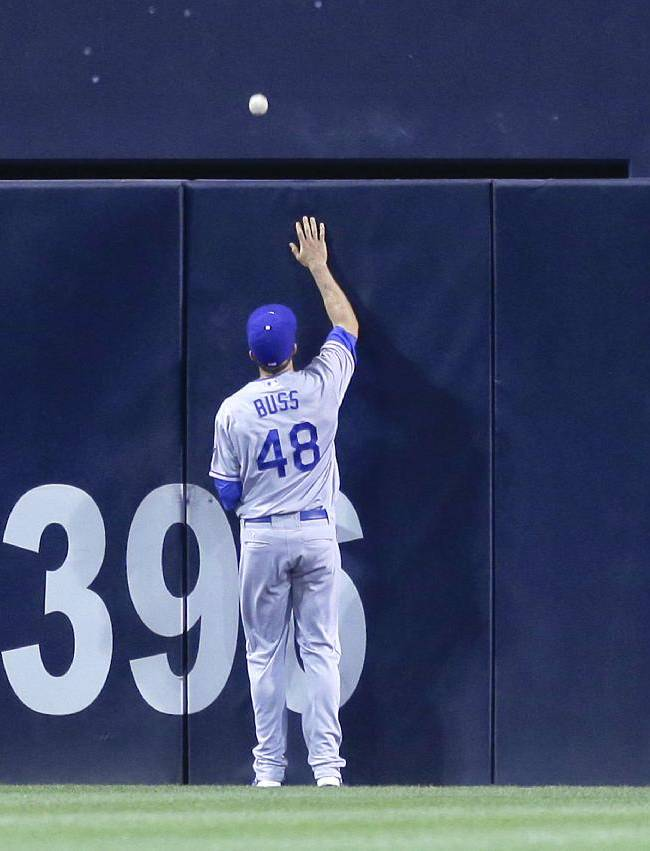 Los Angeles Dodgers center fielder Nick Buss watches as a solo home run by San Diego Padres' Jedd Gyorko sails over the wall in the fifth inning of a baseball game Friday, Sept. 20, 2013, in San Diego