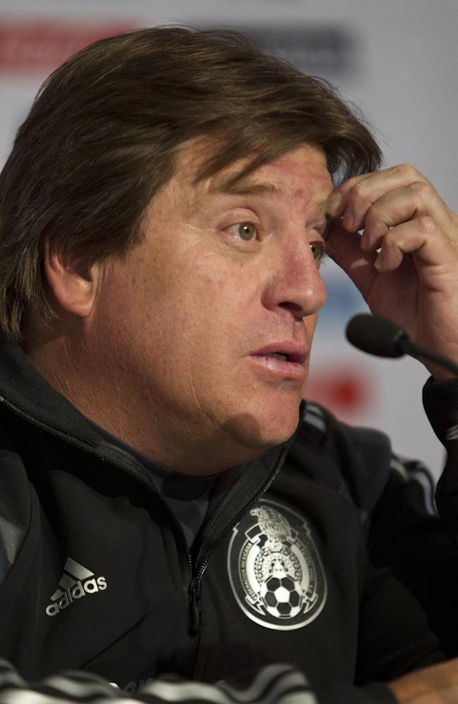 Mexico head coach Miguel Herrera listens to a question during a press conference at the national team's training center in Mexico City, Friday, Dec. 6, 2013, after the final draw in Brazil for the 2014 World Cup. The Mexican national team drew Cameroon, Brazil and Croatia for their World Cup start
